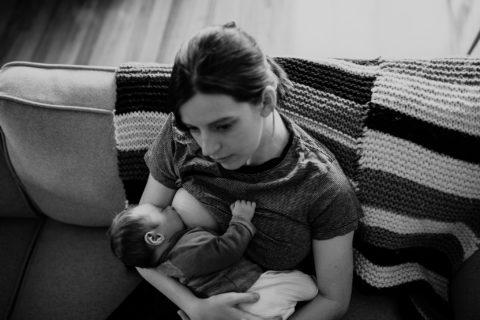 Amy breastfeeding a sleepy Dory